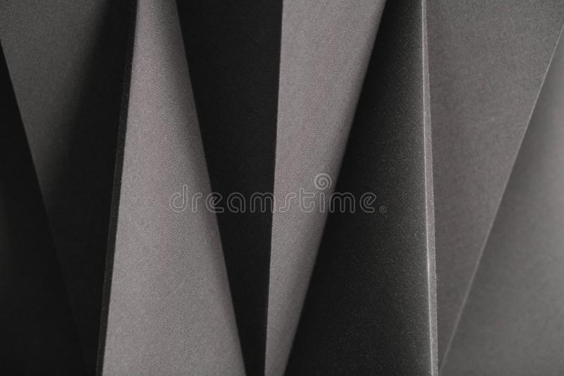 Image of geometric shapes of paper in black and white, three-dimensional effect, abstract background royalty free stock photography