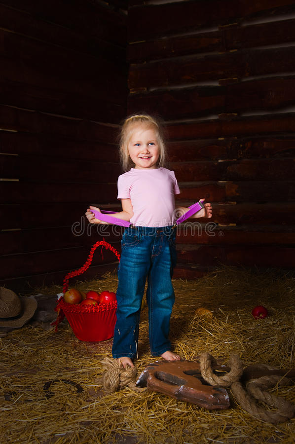 The girl on a mow. The image of the girl having fun on a mow royalty free stock photography
