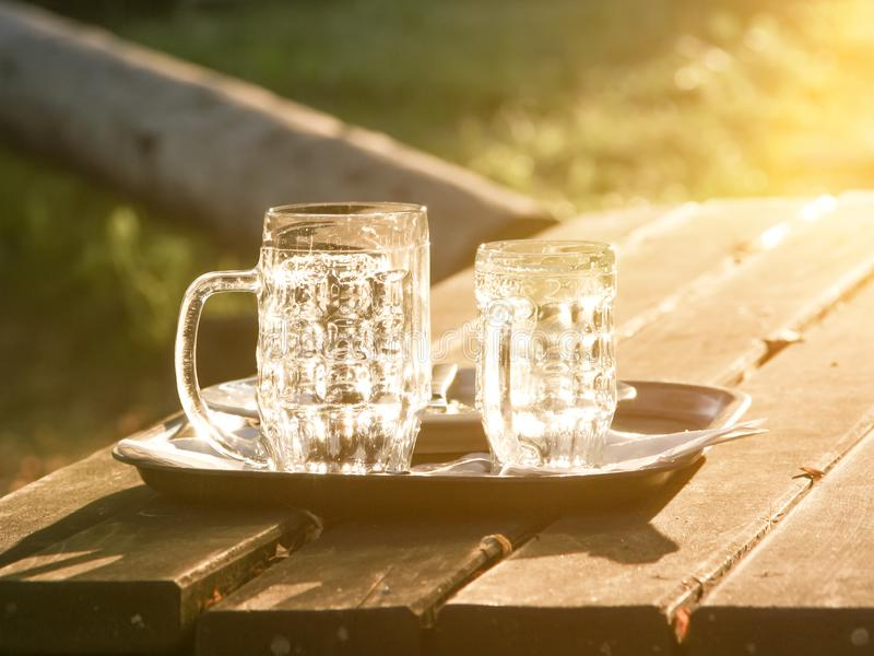 Glass jugs empty in the sunset. An image of glass jugs empty in the sunset royalty free stock photography