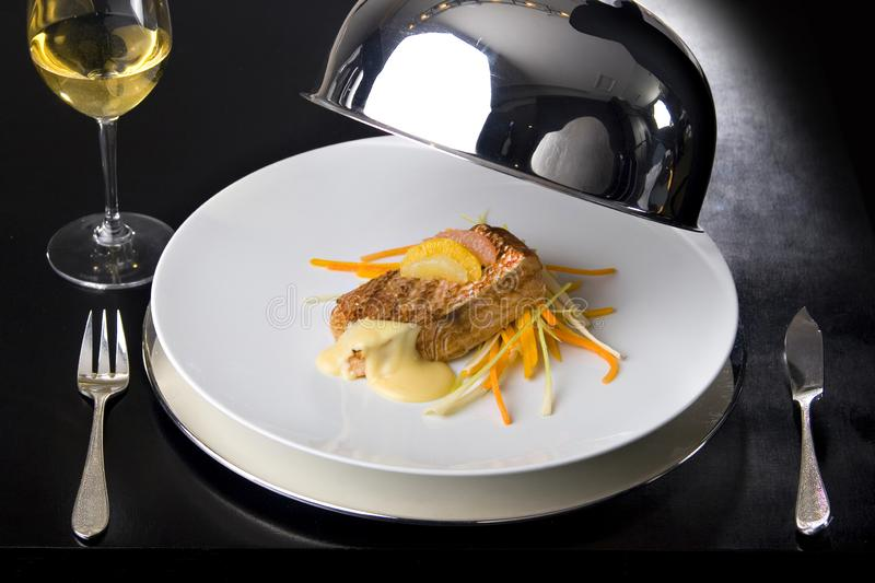Image of gourmet fish dish. Unveiled by the innkeeper royalty free stock images