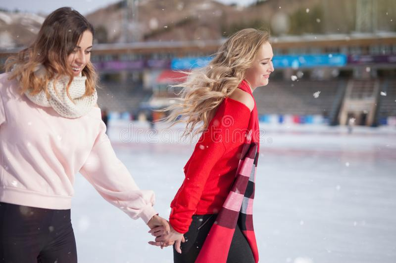 Women ice skating outdoor at ice rink stock photos