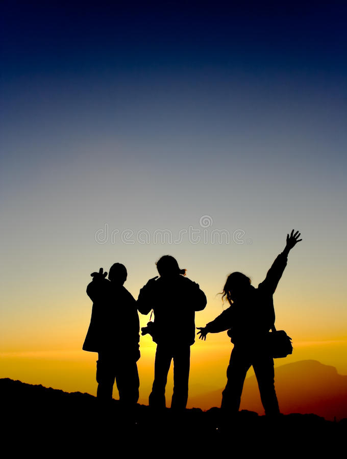 An image a group of men at sunrise. Silhouette stock photos