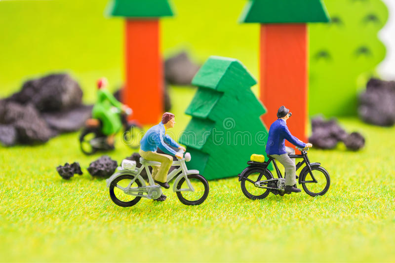 image group of people(mini figure) with retro bicycle in a park royalty free stock photos