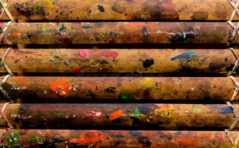 Grunge Bamboo Bars Texture with Colors Spatter for Abstract Background. Image of grunge colorful spatters on bamboo bars texture for background, website, banner royalty free stock photos