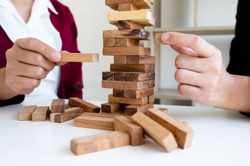 Image of hand holding blocks wood game to growing up of business. Risk of management and strategy plan royalty free stock image