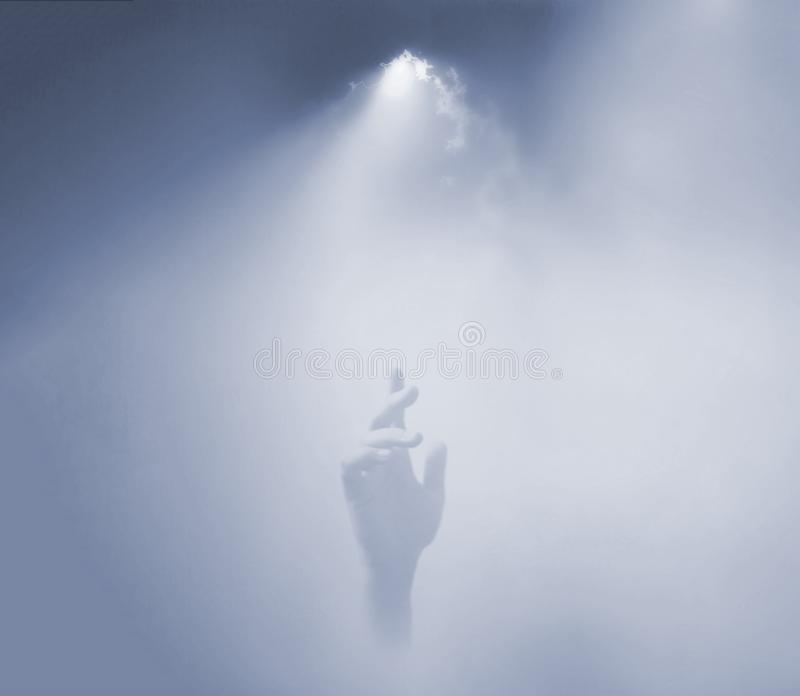 Hand reaching up to the sky. royalty free stock photo