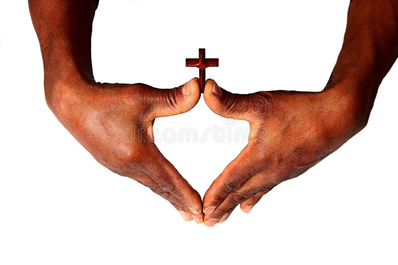 Hands with cross symbolizing love of god. Image of Hands with cross symbolizing love of god royalty free stock photo