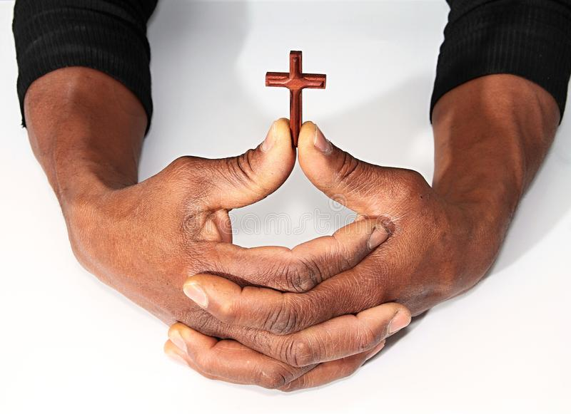 Hands with cross symbolizing love of god. Image of Hands with cross symbolizing love of god stock images
