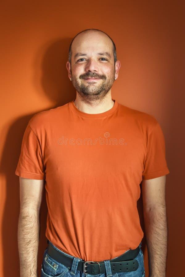 Man with beard orange stock image
