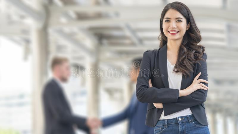 Image of happiness business women stand with confident in fron o. F the blur buiness group talking at outdoor pedestrian stock photography
