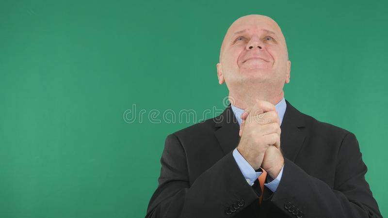 Happy Businessman Make Victory Hand Gestures Looking Up stock photos