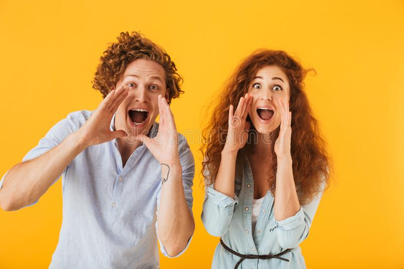 Happy friends loving couple screaming looking camera. stock photo