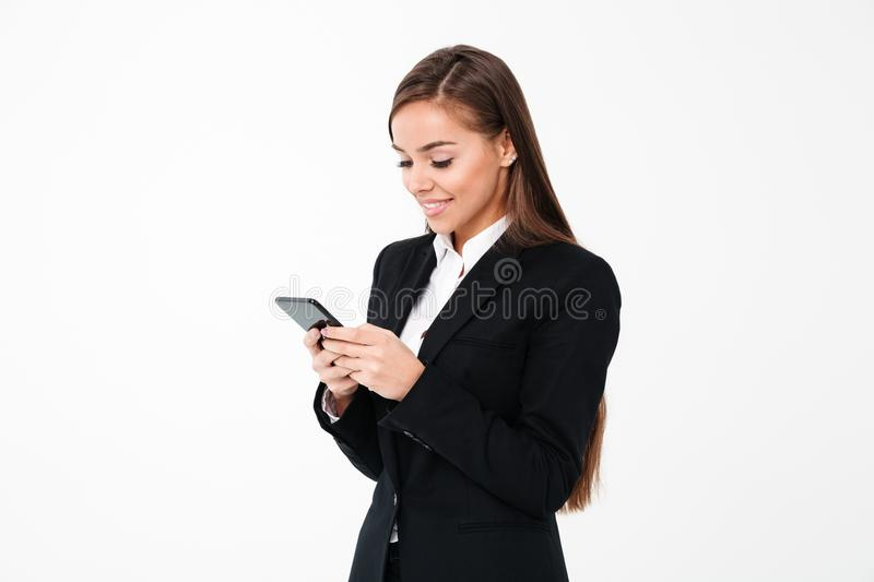 Happy pretty businesswoman chatting by phone royalty free stock photo