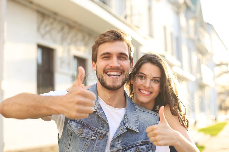 Image of a happy smiling cheerful young couple outdoors take a selfie by camera. royalty free stock photo