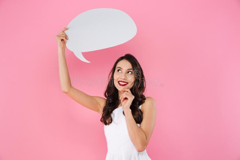 Happy young asian woman holding speech bubble. stock image
