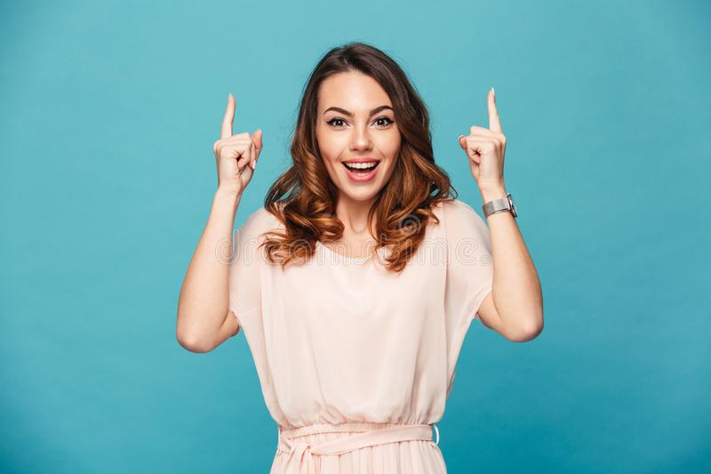 Happy young lady pointing. royalty free stock photo