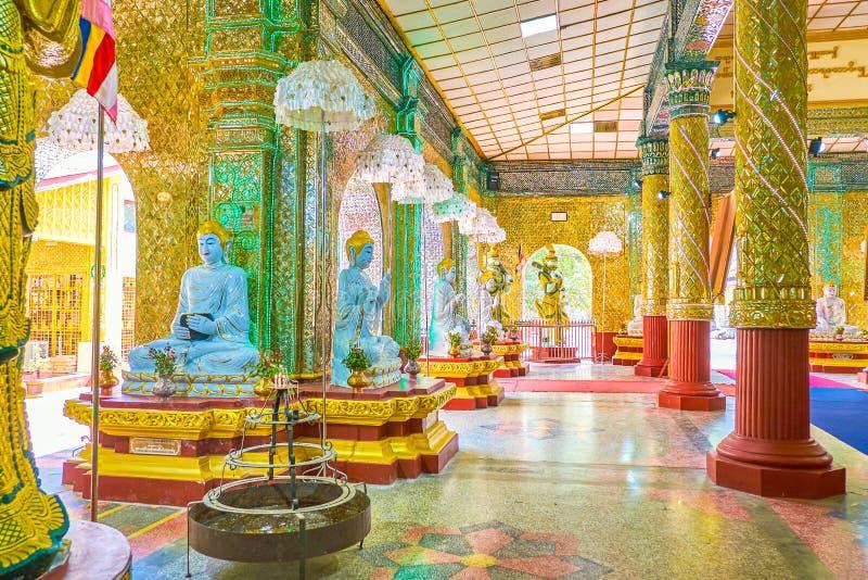 The image house of Kyauktawgyi Buddha Temple in Mandalay, Myanmar. MANDALAY, MYANMAR - FEBRUARY 23, 2018: The beautifully decorated image house of Kyauktawgyi stock image