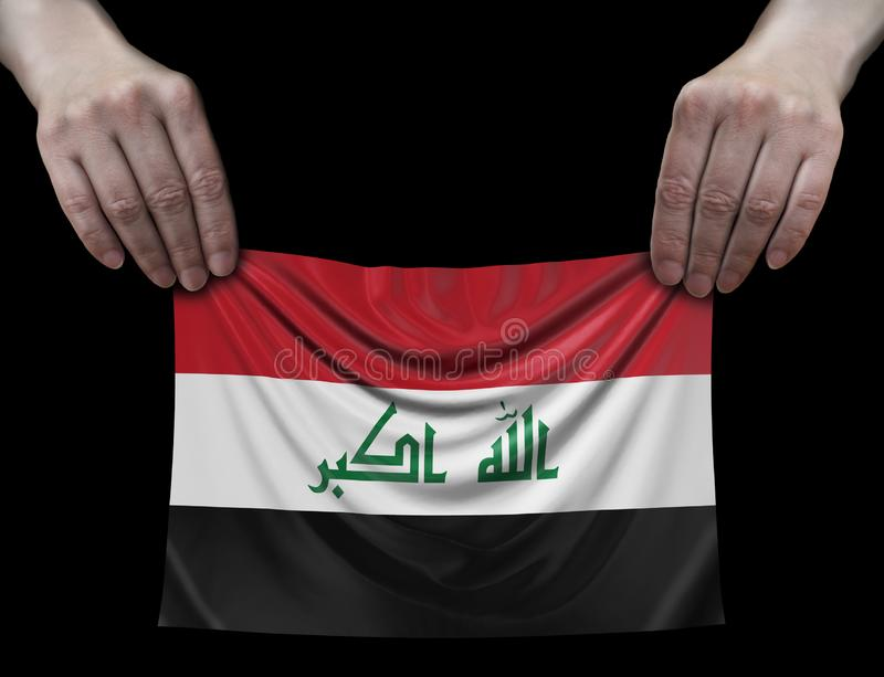 Iraqi flag in hands stock images