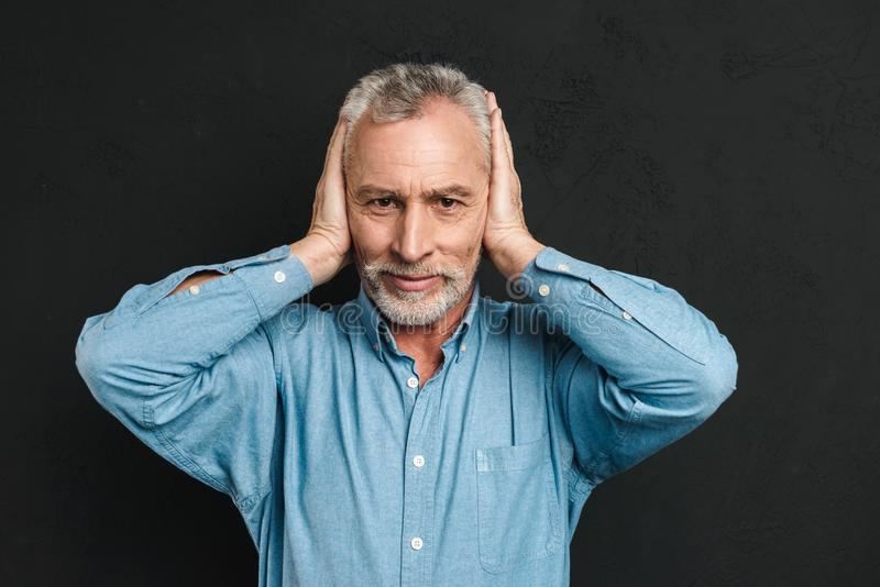 Image of irritated man 50s wearing shirt grabbing his head and c stock photos