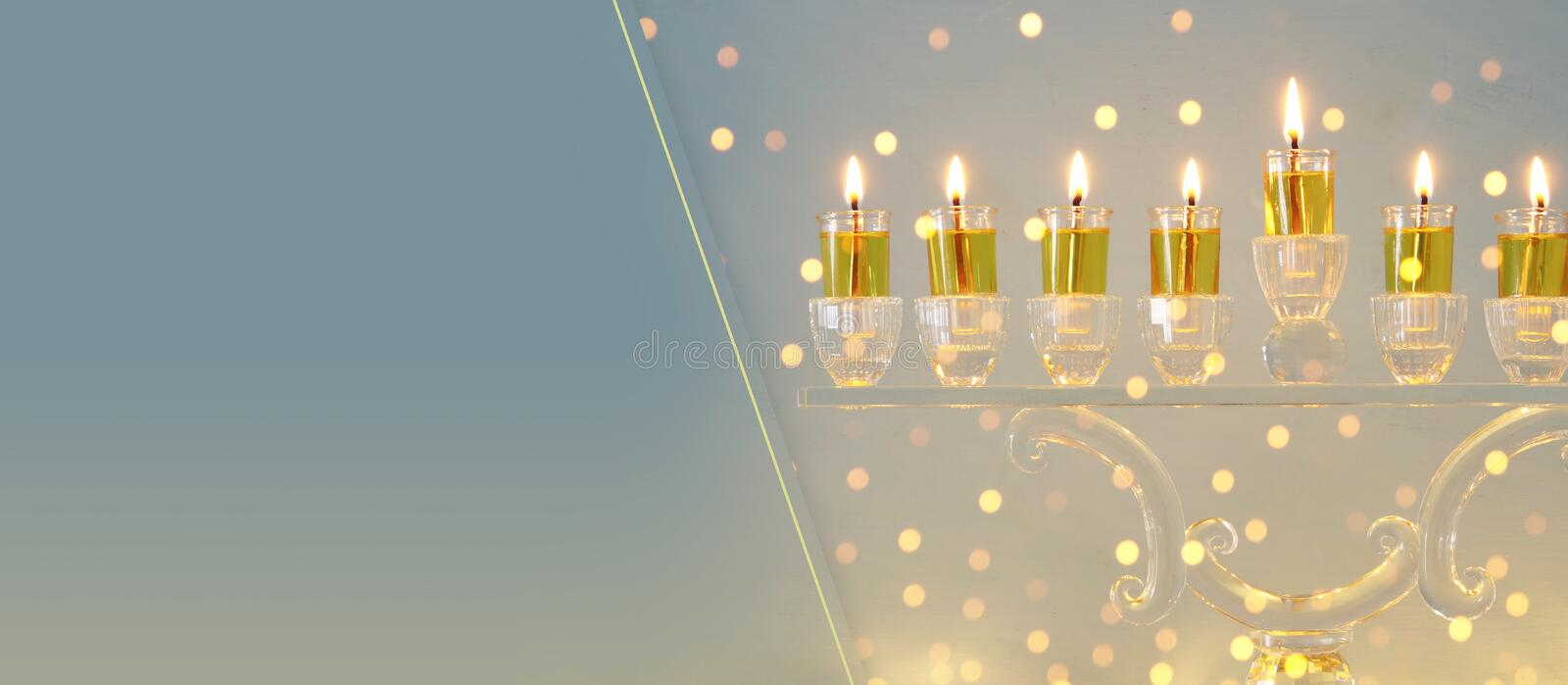 image of jewish holiday Hanukkah background with crystal menorah & x28;traditional candelabra& x29; and candles. royalty free stock image