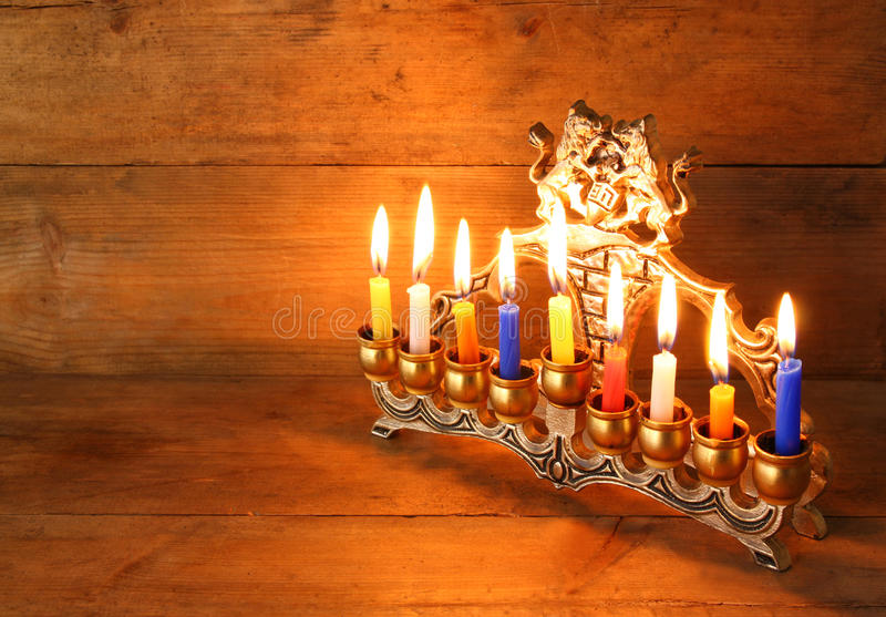Image of jewish holiday Hanukkah background with menorah (traditional candelabra) and Burning candles royalty free stock photos