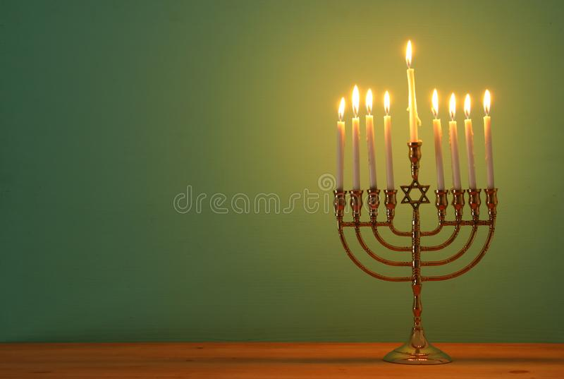 image of jewish holiday Hanukkah background with menorah (traditional candelabra) and candles. royalty free stock image