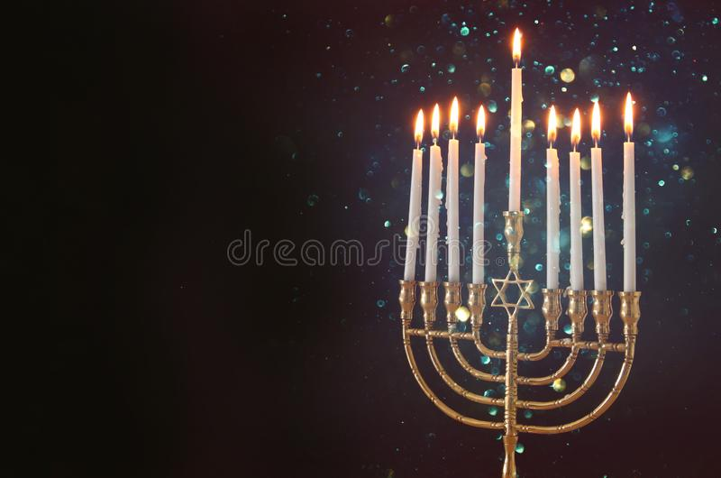 image of jewish holiday Hanukkah background with menorah & x28;traditional candelabra& x29; and candles. royalty free stock photos