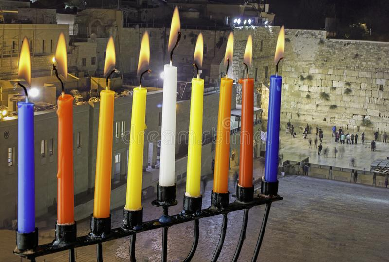 Image of jewish holiday Hanukkah with menorah (traditional candelabra) and burning candles on Jerusalem background. royalty free stock photo