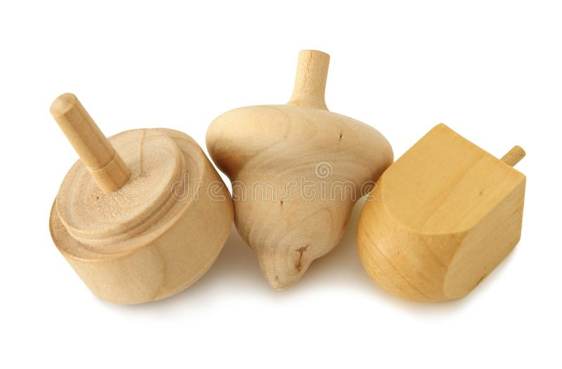 Image of jewish holiday Hanukkah symbol: wooden dreidel & x28;spinning top& x29; isolated on white.  stock photos