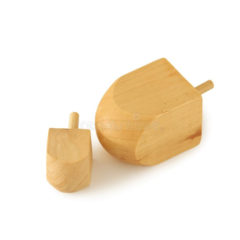 Image of jewish holiday Hanukkah symbol: wooden dreidel & x28;spinning top& x29; isolated on white.  royalty free stock photos