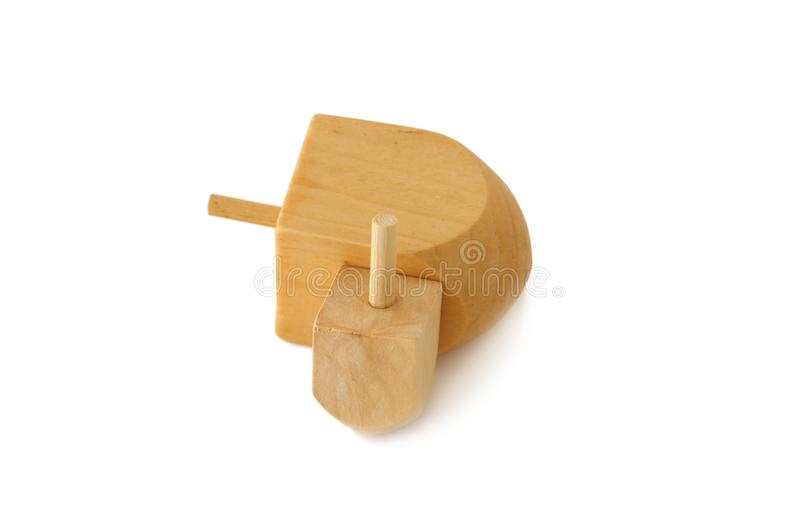 Image of jewish holiday Hanukkah symbol: wooden dreidel & x28;spinning top& x29; on white.  royalty free stock photo