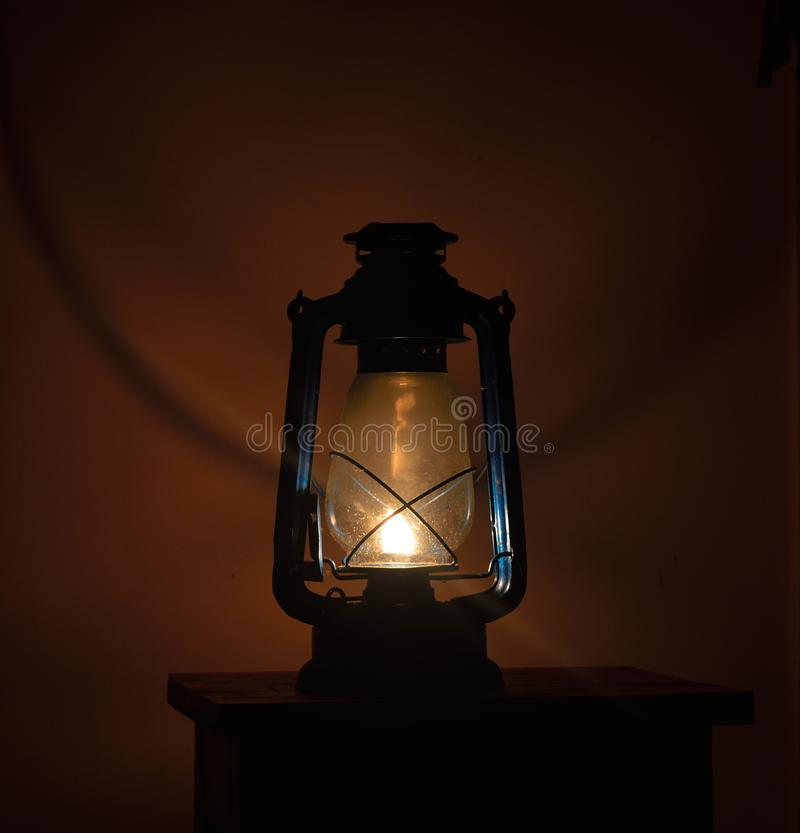 Image of a lantern on a stool in the dark royalty free stock photography