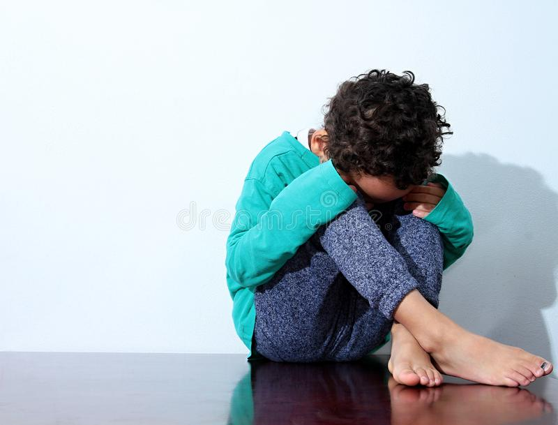 Boy crying in poverty royalty free stock photography