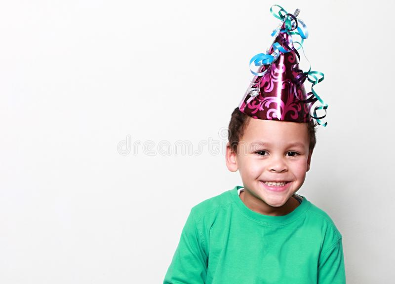 Little boy wearing a party hat and celebrating New Years royalty free stock images