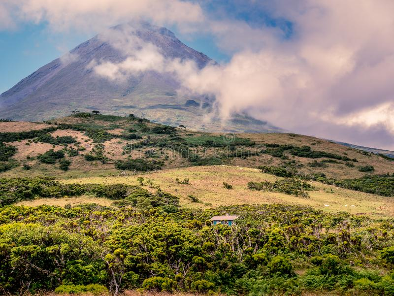 Image of little house below the big mountain of pico stock images
