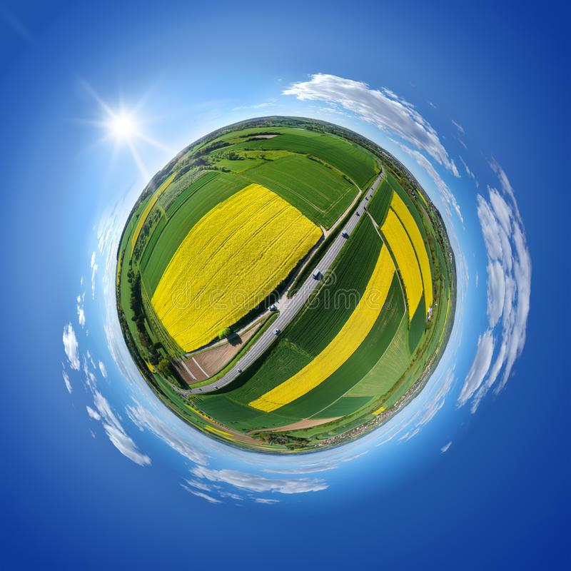 little planet rural rape fields and road stock photography