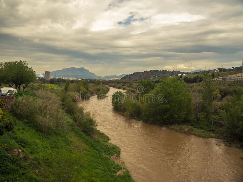Image of the llobregat river after a flood caused by storms. You can see Montserrat, as well as roads and highways royalty free stock photography