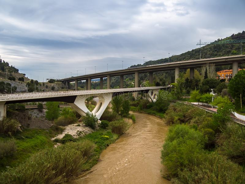 Image of the llobregat river after a flood caused by storms. You can see Montserrat, as well as roads and highways stock image