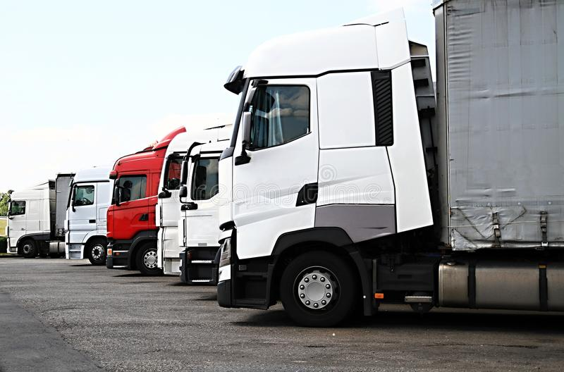 Lorries parked up outside a company`s car parking area. Image of lorries parked up outside a company`s car parking area stock photography