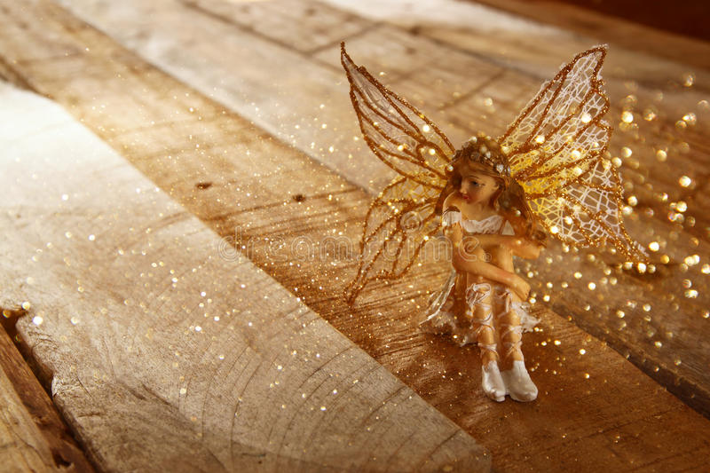 Image of magical little fairy in the forest . vintage filtered. stock photography