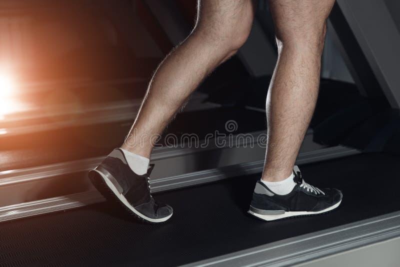 Image of male foot running on treadmill. Image of male foot running on treadmill royalty free stock image