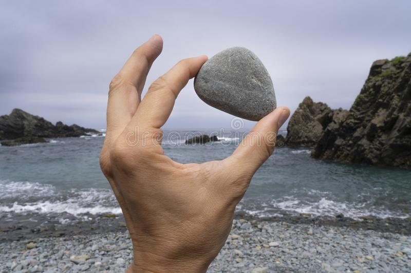 Hand holding a stone stock image. Image of recreation ...