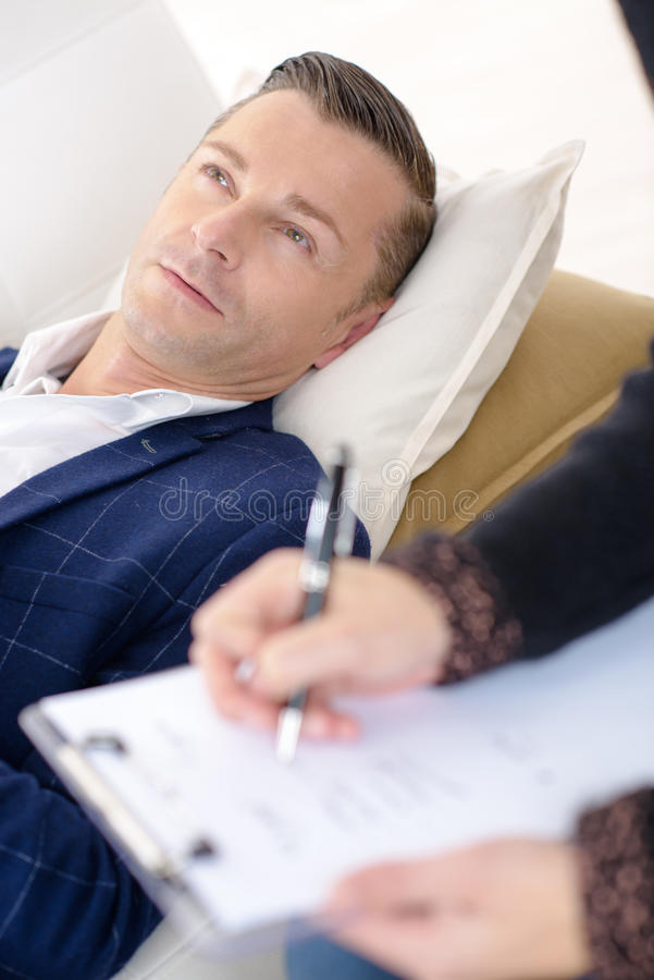 Image male patient speaking to psychiatrist stock photos