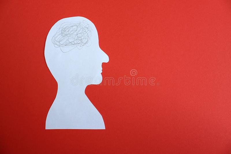 Image of a man man cut out of paper cartoon chaos in his head royalty free stock images