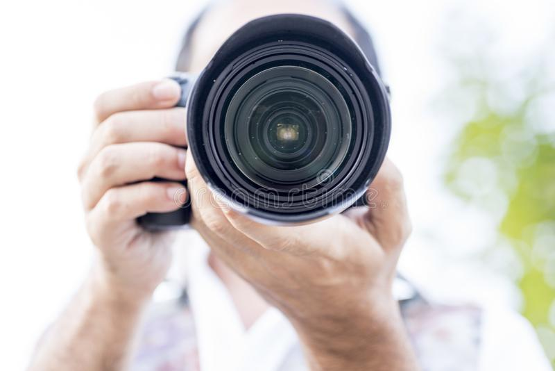 Image of a man photographing stock image