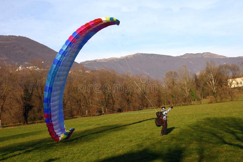 Image of man practicing parachuting over mountain landscape royalty free stock photo