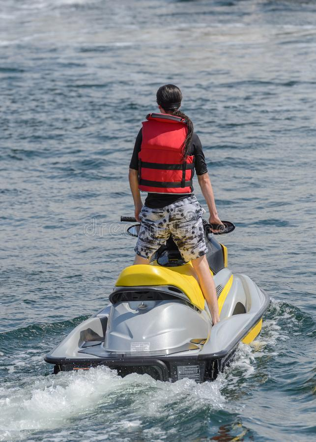 Man is riding a hydrocycle. Image of man is riding a hydrocycle royalty free stock images