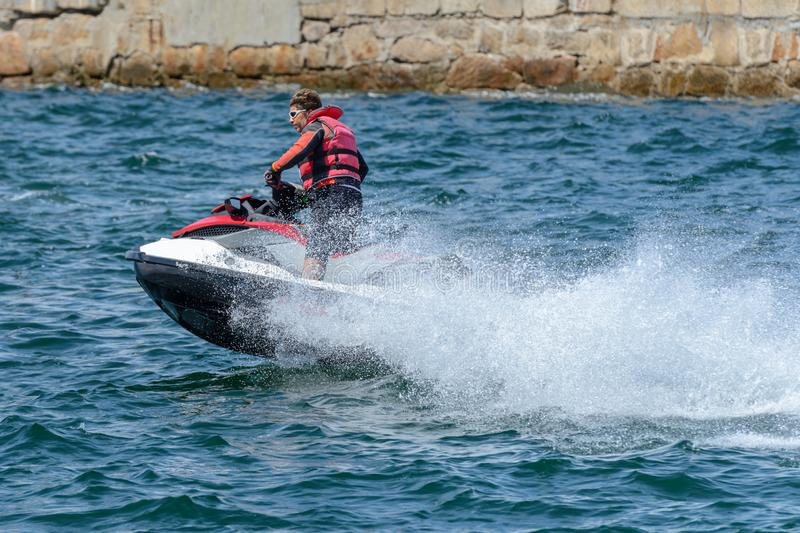 Man is riding a hydrocycle. Image of man is riding a hydrocycle royalty free stock image