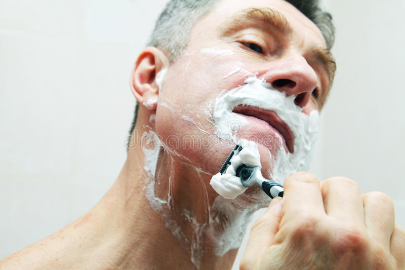 Download Image of man shaving stock photo. Image of adult, grizzled - 28598262