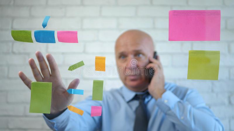 Manager Image Talking to Cellphone  Explaining and Gesturing royalty free stock images